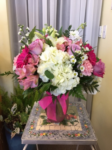 Pink flower arrangement with Roses Hydrangea and Lilies